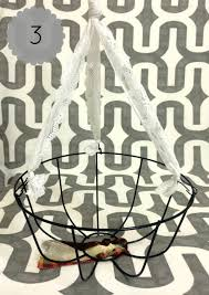 step three unclip the chains that hang the basket then remove the top hanger and clips and replace them with lace ribbon