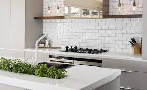 feature timber shelves a spanish handmade subway tile splashback and a bronzed mirror clad