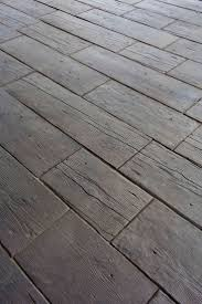 No - thick concrete pavers. 'Barn Plank Landscape Tile' by Silver Creek  Stoneworks, Rochester, MN. Ideal for outdoor paths, decks, etc.