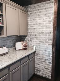 brick panels painted white brick backsplash paint color studio taupe by behr