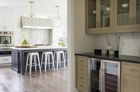 taupe butlers pantry with white marble slab backsplash