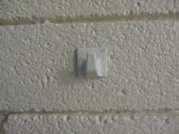 how to hang a picture on a brick or concrete wall