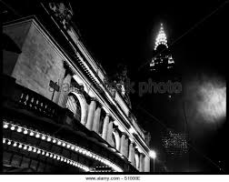 chrysler building black and white at night. grand central station and the chrysler building lit up on a rainy foggy night in black white at