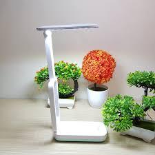Đèn led để bàn KM-6723 2 chế độ sáng, Đèn Led Cảm Ứng Để Bàn 28 Bóng Led -  Đèn Tích Điện Sạc Pin - Đèn Học Chống Cận giảm chỉ còn 190,000 đ