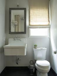 amazing bathroom features walls clad in faux bois wallpaper lined with a restoration hardware pharmacy wall mount medicine cabinet over a wall mount sink