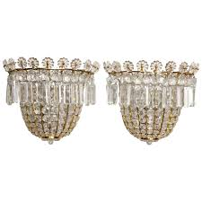 a pair of crystal beaded sconces for