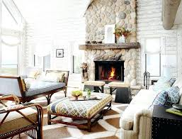 river rock fireplace painted white log cabin living space with stone fireplace and painted white wood river rock