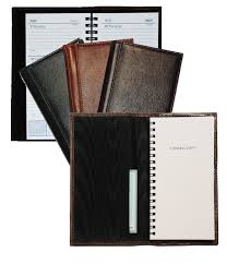 inside and outside views of black burdy and cognac leather pocket size planners