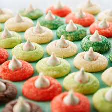 In a large bowl, using an electric mixer cream together the butter and sugar until smooth, then add the egg and vanilla. Celebrate The Holidays With Hershey S Kisses Sugar Cookie Blossoms