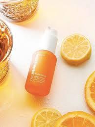sephora spray bottle with slices of orange near it