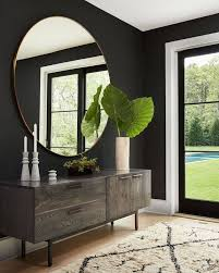 living room wall mirrors. home decor homepolish\u201cwe like our mirrors and fresh-cut greens we dinner portions: huge. living room wall