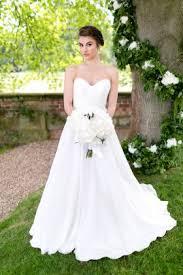 a line chiffon wedding dress. crisscrossed sweetheart strapless simple ivory a line chiffon wedding dress 1