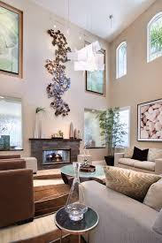 luxurious contemporary livingroom natural wall decor features modern pendant light and wall sculpture paired high ceilings