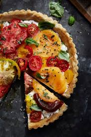 VEGETARIAN Heirloom Tomato Tart with Basil. When made with tomatoes in a  variety of colors and sizes, this elegant tomato tart becomes a showstopper  on your ...