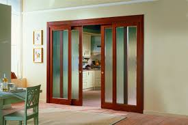 elegant design of the sliding interior doors with red brown wooden color materials added with white
