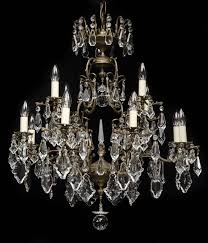 large 12 light antique italian brass chandelier with large crystal prism drops crystal leaves