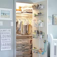 white elfa classic nursery closet with utility door wall rack