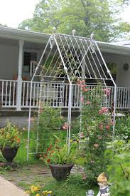 Old Iron Baby crib turned into an arbor for the garden. Anyone have a spare  metal baby crib I can have?