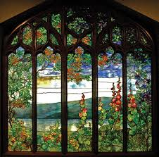 stained glass window in a five part wood frame and depicting a landscape view
