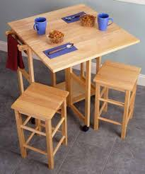 drop leaf dining table w 4 hideaway folding chairs. drop leaf kitchen tables for small spaces dining table w 4 hideaway folding chairs