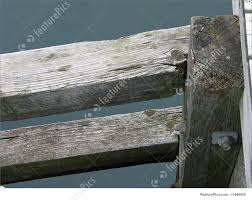 close up details of parts of a wooden dock