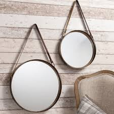 set of two industrial style round hanging mirrors with leather straps