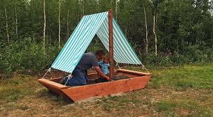 boat sandbox diy this adorable boat sandpit features a fabric sail that acts as a sunshade it is just right in size for a couple of small children