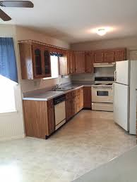in the existing kitchen we had stained oak cabinets with dated appliances vinyl flooring laminate countertops and a peninsula with spindles