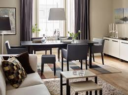 dining room sets ikea: a dining area with a black brown dining table combined with dining chairs with armrests