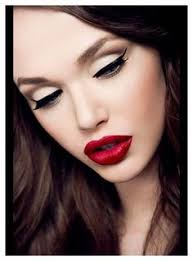 makeup tips for las over 40s beauty hair shot long highlighted bright red hair w messy wave deep red lips a heavy