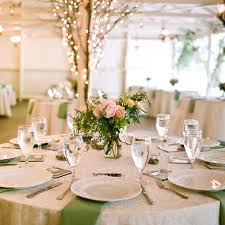 wedding decoration ideas rustic country wedding reception decorations with small pink flowers on round tables
