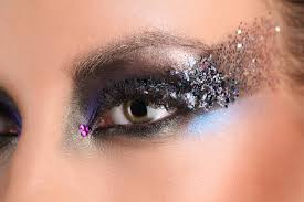 afterward using face glue and sequins outline a cat eye above the already done eyeshadow and fill it up with sequins the result will be a cat eye