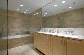recessed lighting for bathroom. solid wood vanity tiled cupboard recessed lighting for shower drawer bathtub glass clear door rectangular mirror white sink bathroom