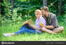 romantic date at green meadow couple in love spend leisure reading book romantic couple students enjoy leisure with poetry nature background