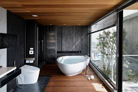 modern bathroom in black with a timber floor glass wall Ideas