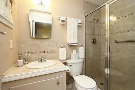 white paint colors for bathroom with beige tile with small mirror and undermount bathroom sink