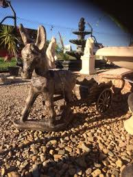 concrete statue donkey and cart