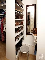 don t just build a wall raise a partition that brings utility to a small walk in closet design this bookcase divider handily holds shoes galore and