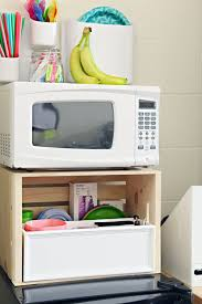 use a wood crate under the microwave to hold kitchen essentials
