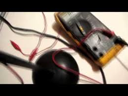 using a multimeter read voltage on a light socket