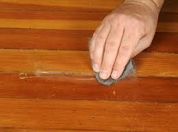 repair deep scratches using steel wool sandpaper wood filler and a few more tools