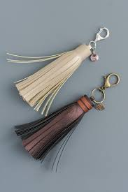 add them to easy diy leather tassels use a cricut machine for the cutting add charms or