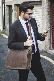 images?q=tbn:ANd9GcT0EtlEshaU L WbyJtQEPq9Fl6GzY srXa w2S6FXihPSuUFin - How To Wear A Messenger Bag With A Suit For Men