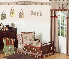 toddler boy bedroom ideas fireplace mantel firewood storage floor lamp foot of the bed grey monochromatic neutral colors roman shades side table upholstered