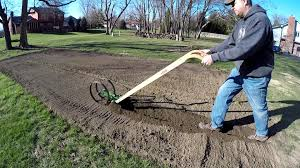using the hoss wheel hoe plow set to make and cover rows