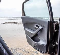 an open car door against the sea storm on the sea stock image