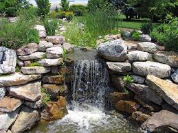 a rock waterfall is a simple feature that s also very easy to put together leave enough of a gap with the piled rock and simply pump water over