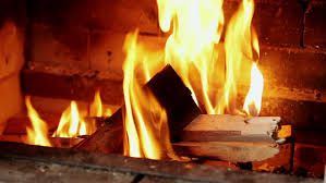 burning chop wood in the stone fire place from fire bricks
