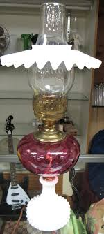 fenton cranberry electric oil lamp with milk glass base and shield 19 1 2