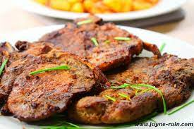 pan fried pork chops in garlic onion